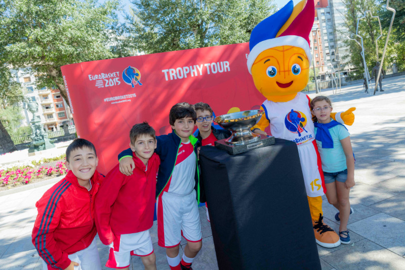 Fans have their photo taken with the EuroBasket trophy and mascot Frenkie during the Trophy Tour stop in Burgos